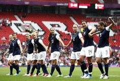 Abby Wambach celebrates with teammates after scoring against North Korea during their group G women's soccer match. ♥
