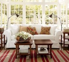 A few Kilim pillows on a sofa. Love the lamps!