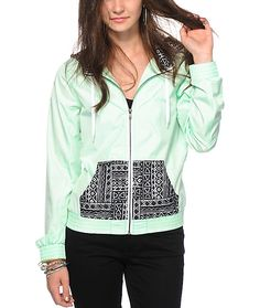 Don't let the weather cramp your style with this lightweight windbreaker jacket made with a Mint body and contrasting tribal print pockets and hood.