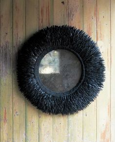 """strips of coconut shell with mercury glass mirror also available in white overall diam 75cm (29½"""") mirror diam 37cm (14½"""")"""