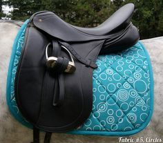 MADE TO ORDER Turquoise Saddle Pad Many Prints by PaddedPonies, $68.00. There's even a Giraffe print!!