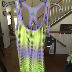 Nike Ladies Dri-fit Training Tank Nike Dri-fit Training Tank has a built in bra for extra support. Bra has mesh wick away structural to keep your workout comfortable. Nike Tops Tank Tops
