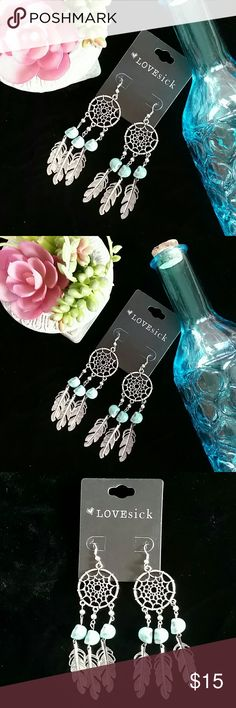 Dream Catcher Earrings NWT! Dream Catcher Earrings with turquoise colored skulls!  💲Bundle & Save!💲😀 🚫No Trades/No Holds 🙄😘  🔘Use OFFER button to negotiate👍🤑 ❔Please Ask ?'s BEFORE you Buy🤔😃 💕Thank you for shopping my closet!💕 Real Haute Trends  Jewelry Earrings