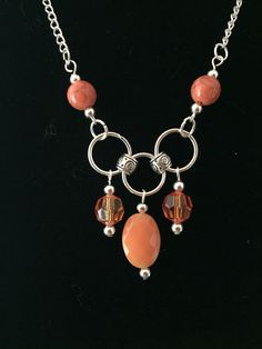 A personal favorite from my Etsy shop https://www.etsy.com/listing/486336480/orange-silver-crystal-beaded-necklace