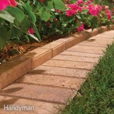 Love this paver edging - supposed to give a flat edge for the lawnmower as well as keep mulch in.