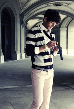 """Like Gong-Yoo, Oh Ji-ho has a great frame to fill out a suit but looks more natural in a slightly casual, preppy variant. This """"chic traveller"""" concept makes the sailor-stripe look a little more plausible, as well as his rumple-cute hair over immaculate slacks and sweaters. Oh Ji-ho generally strikes me as eye candy and not much more, but this shoot kind of makes me want to see him play the irresponsible rich-boy to some firecracker of a heroine…"""