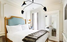 Elegant bedroom with a large chandelier and a wardrobe