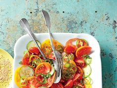Serve a slice of summer with a tomato and cucumber salad. The vinaigrette is made with salty soy sauce, but berfore serving, sprinkle a...