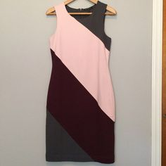 Banana Republic dress New with tags. Maroon, gray and pink Colorblock Ponte sheath dress. Back zip closure. Built-in slip. 66% rayon 29% nylon 5% spandex. Lining is 100% polyester Banana Republic Dresses