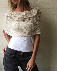 This enchanting warm, neutral colored cream poncho is knitted from a beautiful Alpaca yarn – a yarn known for its durability and warmth. Because it is made from a natural fiber it has slight variations in the tone which adds to the uniqueness of this garment accessory. This yarn has been discontinued so this is a Limited Edition item. I have a very small quantity of this yarn. One of my favorite ponchos, this is guaranteed to keep the chill off your back, chest and shoulders. It is a…