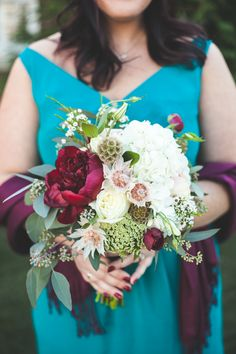 Bridesmaid detail for a fall wedding. Bouquet of maroon & ivory flowers. Dress: David's Bridal F15530 in Oasis. Venue: Belmont Country Club in Ashburn, VA |  Photo Credit: http://www.maddiekdoucet.com #bride #fallwedding #davidsbridal #oasis #flowers #bouquet