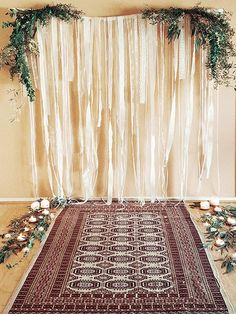 Wren & Rabbit Event Production - Styling Inspiration - Boho Botanical Aisle. Vintage lace altar backdrop, lots of candles and greenery and an afghan rug make up a beautiful ceremony space!