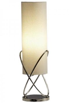 Sophisticated lamp, perfect for sofa table positioned in front of a window.