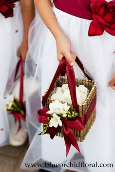 Flower Girl basket containing cream Rose petals -- created from a twig box with red ribbons, and accented with white Freesia - by Heather Murdock of The Blue Orchid (image by Kuperberg Photography)