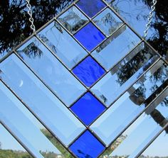 A sparkling big blue stained glass glass panel. Diagonal beveled glass reflects many rainbows all year long. Blue Stain, Small Windows, Beveled Glass, Science And Nature, Glass Panels, Suncatchers, Solar Power, Stained Glass, Abstract