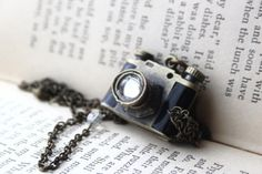 The perfect gift for a photographer, photo lover, or somebody who just loves jewelry!     The Camera is a locket <3