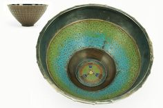 """Ludwig Vierthaler (German, 1875-1967) A Bowl. Made for J. Winhart & Co, Munich, Germany circa 1889. A magnificent tour-de-force example of the metalsmith's art. The base of this large bronze bowl was cast and then hand carved with a hammer and chisel to resemble a woven basket. Uprights and arches between, and three rows of weaving at base which is footed and two rows at top. Wide at the top, curving down to a narrow foot. The top edge and inside rim for about 2"""" downwards into the bowl is…"""