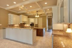 Kitchen with Coffered Ceiling Custom Home at Black River Estates - Ron Lee Homes