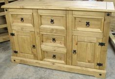 Mexican Corona 2 Door 5 Drawer Pine Sideboard    Same again, but amazon    Mexican Corona 2 Door 5 Drawer Pine Sideboard  by mercers furniture     Price:£118.00  In stock.  Dispatched from and sold by mercersfurniture.  Solid pine with ply backs and draw bases  Easy home Assembly  H84 x W132 x D44