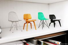 LITTLE BITTY EAMES CHAIRS ALL LINED UP ON A SHELF. (via @domainehome)
