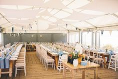 The Gallivant Marquee.  Complete with driftwood tables, laterns, sea shell and bunting. #beachwedddingvenue