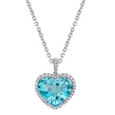 A heart-shape paraiba tourmaline of 8.19 cts. is featured in this platinum pendant, handcrafted with an outline of 0.35 cts. t.w. round brilliant diamonds.    Omi Privé