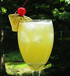 Pineapple In Paradise. Pineapple rum, pineapple juice, vodka and Fanta Pineapple Soda. I'm saying it's 5:00 right now!