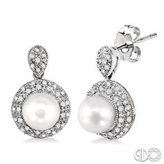 Pearl and pave diamond drop earrings set in white gold.