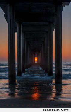 (Scripps Pier, La Jolla, California) The sun only lines up like this twice per year