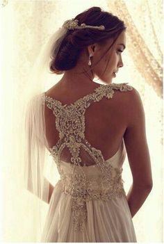 Beautiful classy wedding dress. The back is amazing with such intricate details!