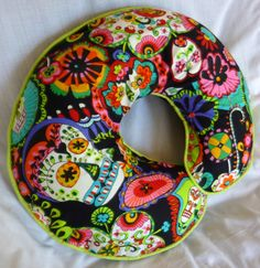 Boppy-doesn't necessarily need to be a boppy, even a home made one would be awesome! Love this print and how colorful it is.   Skull Baby Boppy Nursing Pillow Cover - Fits Boppy Pillows Alexander Henry Folklorico Cabezas De Coyoacán on Etsy, $27.00