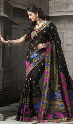 Cast a spell over the masses dolled up in this printed sari, cotton fabric in black color. This gorgeous attire is displaying some superb embroidery done with block print work. Upon request we can make round front/back neck and short 6 inches sleeves regular saree blouse also. #prettydesignsaree #printedsaris #awesomesareescollection