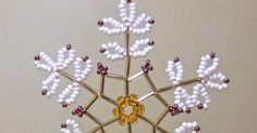 Free detailed tutorial with step by step photos on how to make a snowflake out of beads and bugles. Great for beginners!