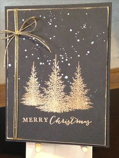 handmade Christmas Card  ... black base (looks slate gray) with metallic gold ... embossed trees and sentiment ... multi-strand string wrap and bow ...  rubbed around the edges ... luv the serene and elegant look ...