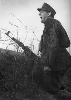 SS soldier with the new STG44 assault rifle- way ahead of its time!