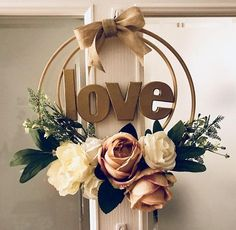 Embroidery hoop and artificial flower wreath Love Bedroom