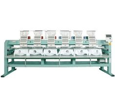 """Tajima Type-2 (TFMX-IIC-1506-450) 6 Head Stretch Looking for an embroidery machine to ramp up your production to a higher level? A Tajima TFMX Type-2 6 head machine is ideal for mid-size orders ranging from 48 pieces to 200 pieces. Plus, the """"stretch"""" version offers the added bonus of an extra-large sewing field. Get it done quickly, efficiently and profitably with the world's leading six-head embroidery machine."""
