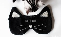 Holidays mean a lot of traveling and not enough sleep on planes. Make this supersoft black eye mask for someone who loves to fly who loves cats!