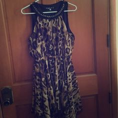 Cheetah Print Style Dress Cheetah Print style dress. Size XL, but defiantly runs as a Large maybe Medium, bought for my prom, was delivered and I tried it on and it was too short on me. I am 6'1, so it was too short for me. Brand new, in packaging still. Dresses Midi
