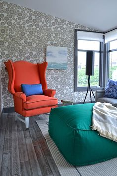red chair green pouf living room seabrook house by brian paquette interiors