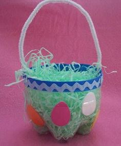 """Soda Bottle Easter Basket instructions. Even small kids could make this Easter craft (with a little help).  Instead of craft foam, you might let the kids color paper """"eggs"""" or flowers to glue on. Oh and they may need litter for extra sparkle. ;-):"""