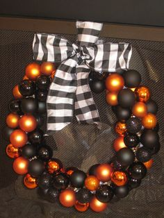halloween ornament wreath, these are so easy to make, just be sure you glue the tops on this is a must, some try to skip that step and live to regret it. lol