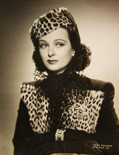 Joan Bennett in a pretty amazing outfit. Leopard, net and sparkly jewellery!