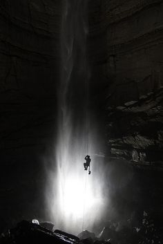 Great photo Alan Grosse took on a caving trip.  This is the bottom of a 246-foot-deep rappel, next to a roaring waterfall in an enormous cave chamber.