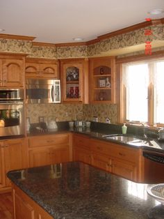 Kitchen soffit steps with cabinets.