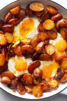 NYT Cooking: Variations of this hearty fried egg-and-potato dish can be found throughout Spain, including the Canary Islands, where it's said to have originated. There's always a runny egg, but whether it sits atop fried potato rounds, French fries or crunchy chips varies by region and personal preference. The potatoes are often served with chorizo sausage or Serrano ham, but in this vegetarian version, smo...