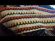 Flowers in a Row Intro - YouTube.  This is by Bethintx1, who is one of the best of all crochet YouTubers.  She is very thorough.