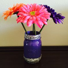 DIY purple with silver glitter Mason jar with multi colored flowers