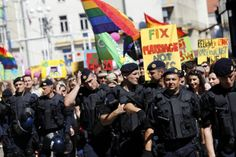 """Riot police secure a gay pride parade in Zagreb, Croatia, June 16, 2012. About a thousand participants attended the Zagreb Gay Pride parade."" (Photo: Antonio Bronic / Reuters)  http://newsfeed.time.com/2012/06/13/lgbt-pride-celebrations-around-the-world/#ixzz2vPwGk59X"
