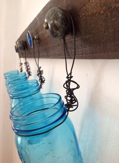Tinted blue glass mason jars hung from rustic reclaimed chestnut wood for unique wall decor, home decor, kitchen storage, bathroom organizer on Etsy, $60.00